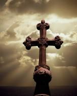 Sunbeams Backlighting Cross --- Image by © Royalty-Free/Corbis
